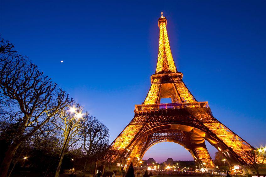 14542823 - paris - apr 20: eiffel tower light performance show at dusk on april 20, 2010 in paris. the eiffel tower is a landmark to paris.